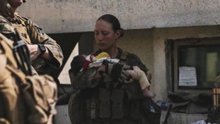 The Tragic End of Nicole J in Afghanistan: The Killing of a Young Marine and the Thrilling Photo with Newborn